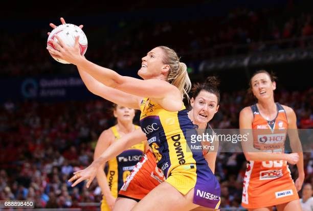 Caitlin Bassett of the Lightning catches the ball during the round 14 Super Netball match between the Giants and the Lightning at Qudos Bank Arena on...
