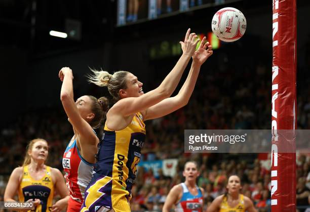 Caitlin Bassett of the Lightning catches the ball ober Sarah Klau of the Swifts during the round eight Super Netball match between the NSW Swifts and...
