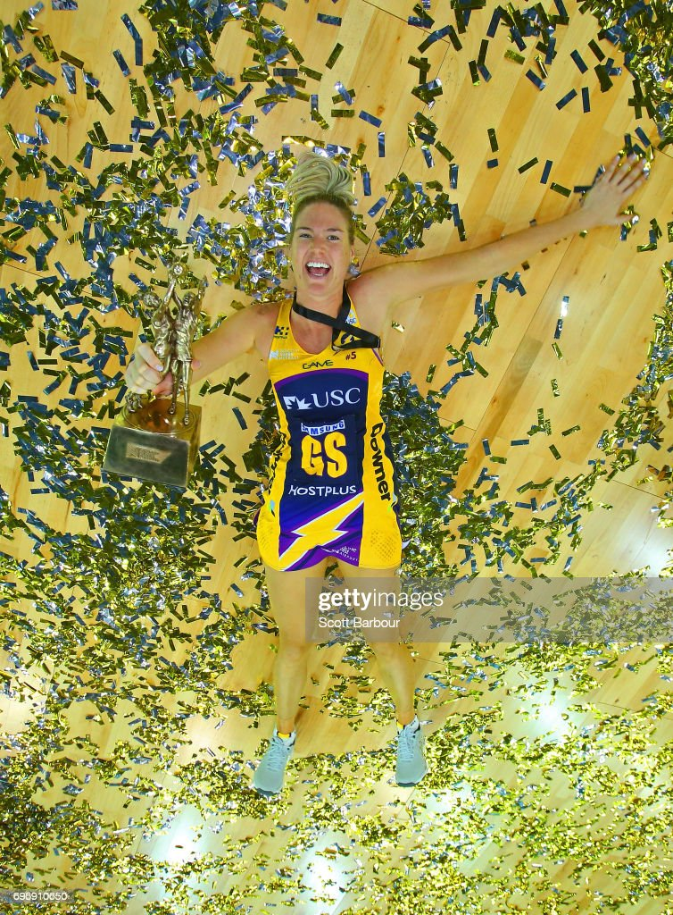 Caitlin Bassett of the Lightning celebrates victory amongst the confetti while holding the Suncorp Super Netball trophy after winning the Super Netball Grand Final match between the Lightning and the Giants at the Brisbane Entertainment Centre on June 17, 2017 in Brisbane, Australia.