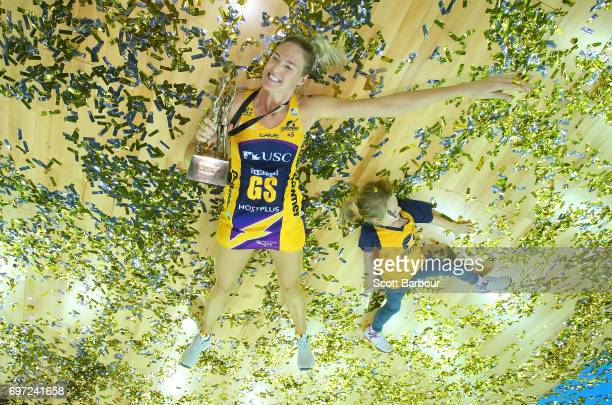 Caitlin Bassett of the Lightning celebrates victory amongst the confetti while holding the Suncorp Super Netball trophy after winning the Super...