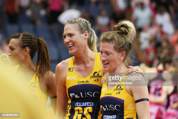 Caitlin Bassett of the Lightning celebrates victory with teammate Karla Mostert following the round three Super Netball match between the...