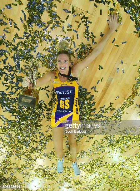 Caitlin Bassett of the Lightning celebrates with the Suncorp Super Netball trophy amongst the confetti after winning the Super Netball Grand Final...