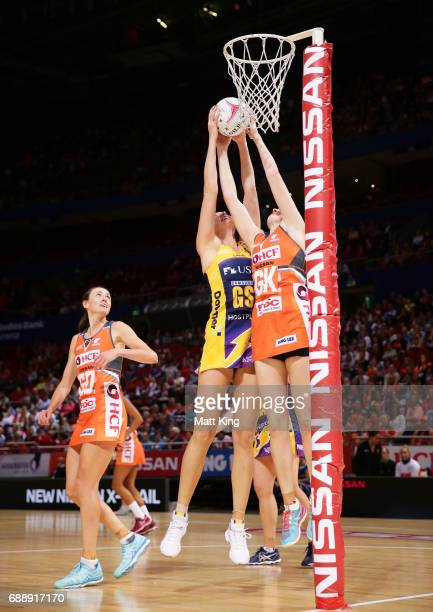 Caitlin Bassett of the Lightning competes with Sam Poolman of the Giants during the round 14 Super Netball match between the Giants and the Lightning...