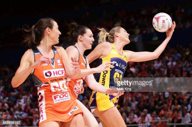 Caitlin Bassett of the Lightning is challenged by Bec Bulley and Sam Poolman of the Giants during the round 14 Super Netball match between the Giants...