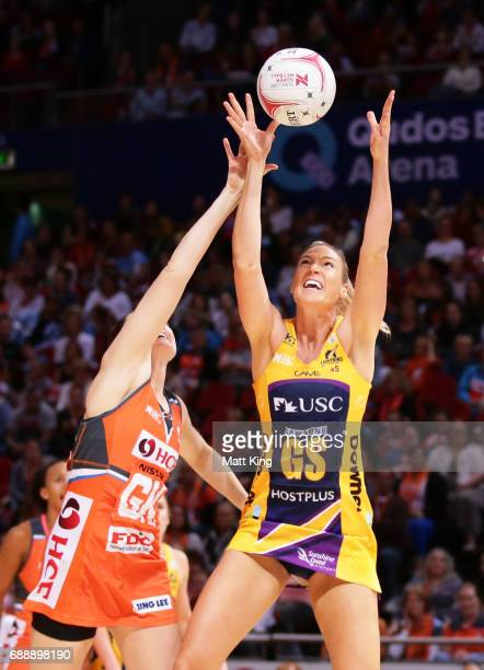Caitlin Bassett of the Lightning is challenged by Sam Poolman of the Giants during the round 14 Super Netball match between the Giants and the...