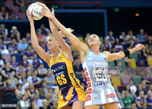 Caitlin Bassett of the Lightning wins the challenge for the ball over Sharni Layton of the Magpies during the round five Super Netball match between...
