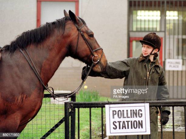 Caitlin Buchanan from Cousland brings her twelve year old horse Sherry to the local polling station where Ms Buchanan voted in the elections for the...