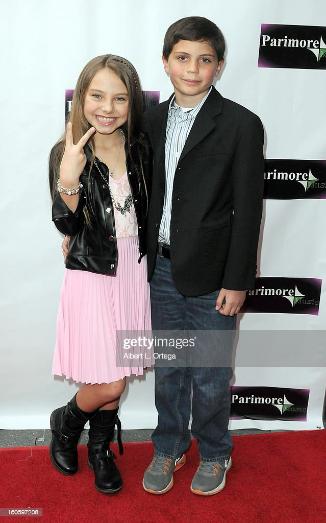 Caitlin Carmichael and Drew Dieffenbach arrive for the All Ages Valentine Bash 2013 held at Infusion Lounge on February 2, 2013 in Universal City, California.