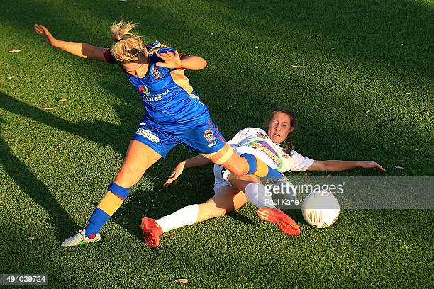 Caitlin Doeglas of the Glory is challenged by Cassidy Davis of the Jets during the round two WLeague match between Perth Glory and the Newcastle Jets...