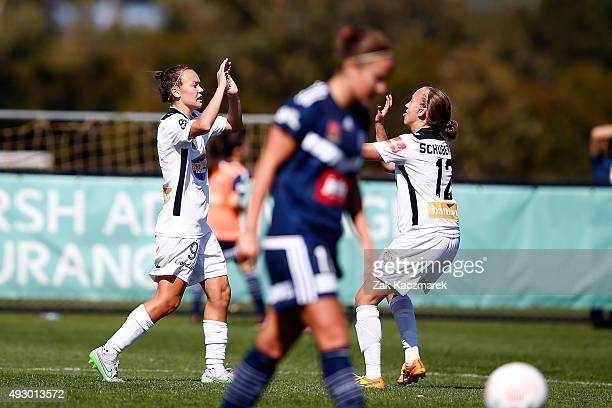 Caitlin Foord and Katie Schubert of Perth celebrate after Caitlin Foord scored Perth's first goal with during the round one WLeague match between the...
