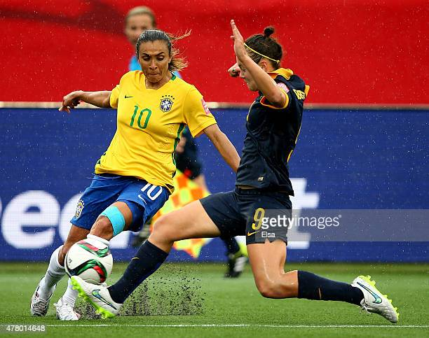 Caitlin Foord of Australia and Marta of Brazil battle for the ball in the second half during the FIFA Women's World Cup 2015 round of 16 match...