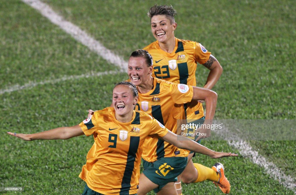 Caitlin Foord of Australia celebrates with her team-mates after scoring against Japan during the AFC Women's Asian Cup Group B match between Australia and Japan at Thong Nhat Stadium on May 14, 2014 in Ho Chi Minh City, Vietnam.