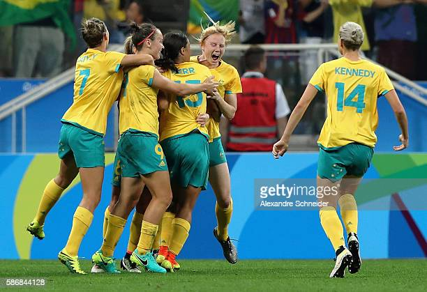 Caitlin Foord of Australia celebrates with teammates after scoring a goal during the first half against Germany in the Women's First Round Group F...