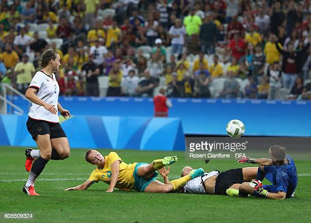Caitlin Foord of Australia is challenged by Leonie Maier of Germany during the Women's First Round Group F match between Germany and Australia on Day...
