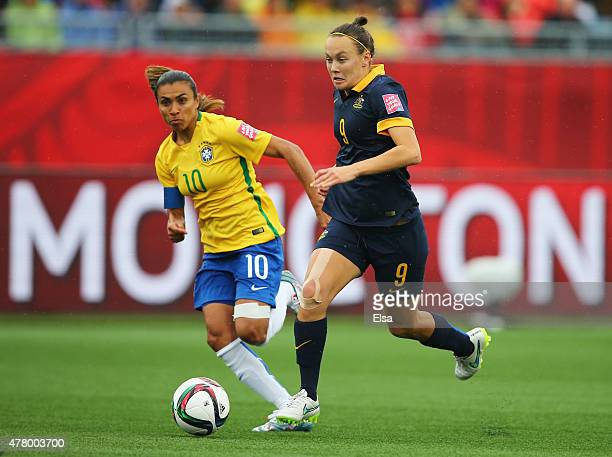 Caitlin Foord of Australia is chased by Marta of Brazil during the FIFA Women's World Cup 2015 round of 16 match between Brazil and Australia at...
