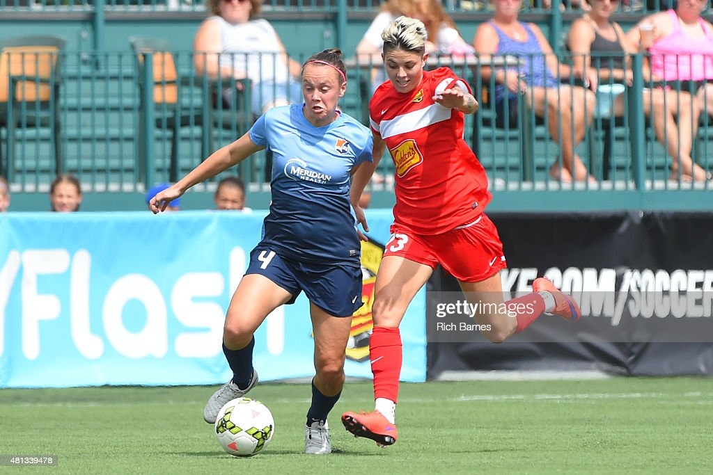 Caitlin Foord #4 of Sky Blue FC controls the ball against the defense of Michelle Heyman #23 of Western New York Flash during the first half at Sahlen's Stadium on July 19, 2015 in Rochester, New York.