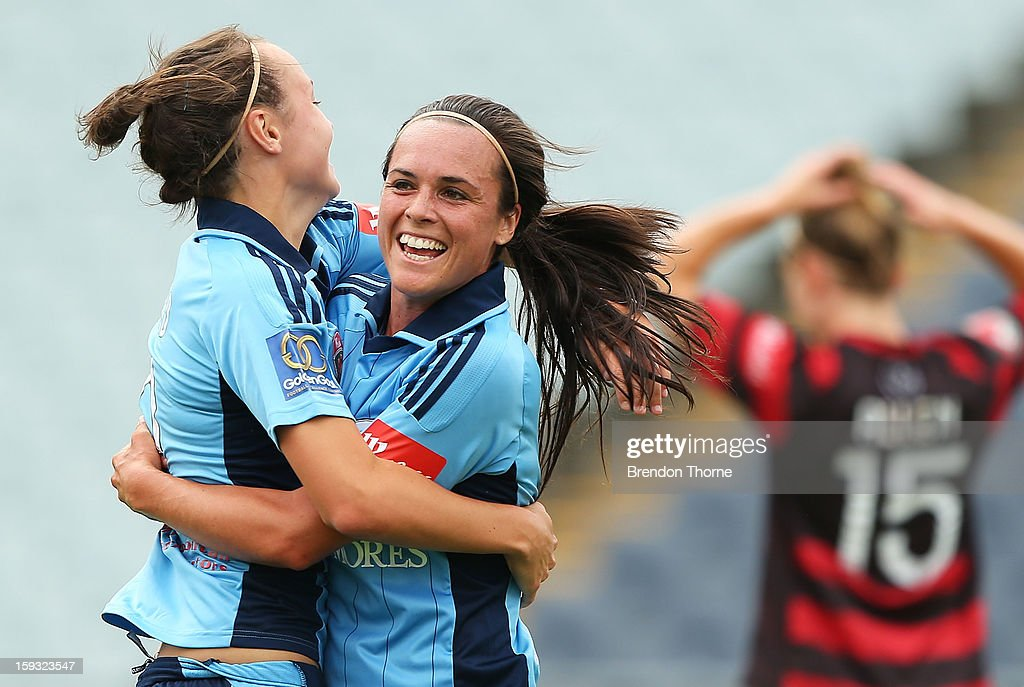 <a gi-track='captionPersonalityLinkClicked' href=/galleries/search?phrase=Caitlin+Foord&family=editorial&specificpeople=7338563 ng-click='$event.stopPropagation()'>Caitlin Foord</a> of Sydney celebrates with team mate Emma Kite after scoring the opening goal against the Wanderers during the round 12 W-League match between the Western Sydney Wanderers and Sydney FC at Campbelltown Sports Stadium on January 12, 2013 in Sydney, Australia.