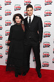 Caitlin Moran and Max Irons pose in the winners room at the Jameson Empire Awards 2016 at The Grosvenor House Hotel on March 20 2016 in London England