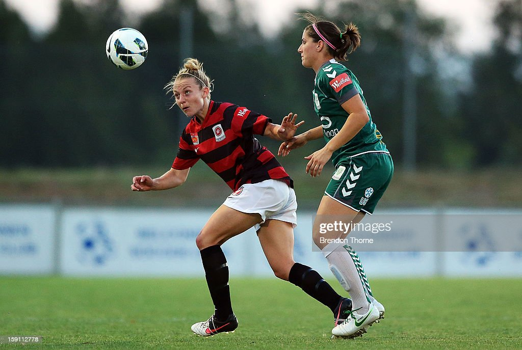 Caitlin Munoz of Canberra competes with <a gi-track='captionPersonalityLinkClicked' href=/galleries/search?phrase=Teigen+Allen&family=editorial&specificpeople=6475598 ng-click='$event.stopPropagation()'>Teigen Allen</a> of the Wanderers during the round 11 W-League match between Canberra United and the Western Sydney Wanderers at McKellar Park on January 8, 2013 in Canberra, Australia.