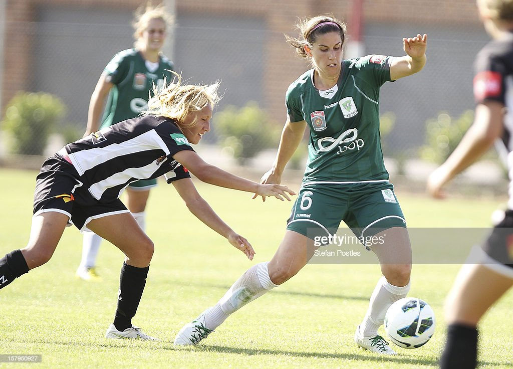 Caitlin Munoz of Canberra United and Gema Simon of Newcastle Jets contest possession during the round eight W-League match between Canberra United and the Newcastle Jets at Deakin Football Stadium on December 8, 2012 in Canberra, Australia.