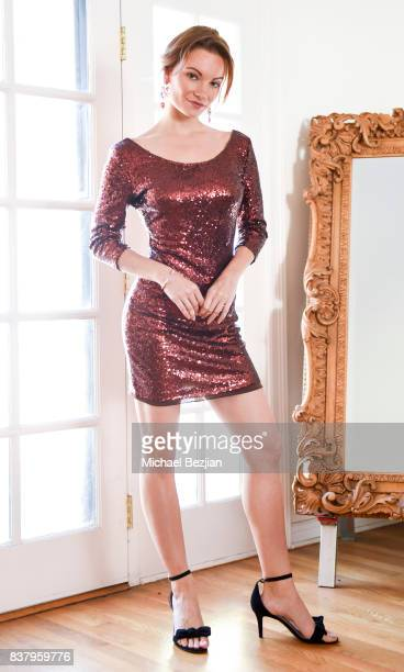 Caitlin O'Connor poses wearing Dalia MacPhee dress Xehar earings and Sterling Forever cuff and rings at TAP The Artists Project Style House on August...