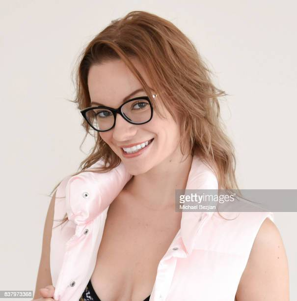 Caitlin O'Connor poses wearing Lizzie Stanton vest while drinking Hint Water at TAP The Artists Project Style House on August 22 2017 in Los Angeles...