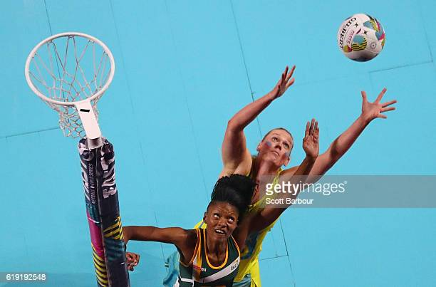 Caitlin Thwaites of Australia and Fikile Mkhuzangwe of South Africa compete for the ball during the Fast5 Netball Series match between Australia and...
