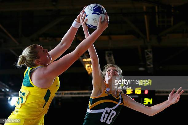 Caitlin Thwaites of Australia and Karla Mostert of South Africa compete for the ball during the preliminary round netball match between Australia and...