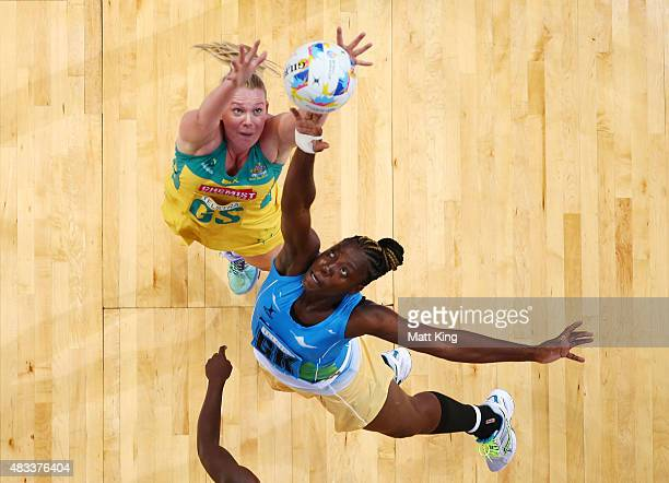 Caitlin Thwaites of the Diamonds is challenged by Shonette Bruce of Barbados during the 2015 Netball World Cup match between Australia and Barbados...