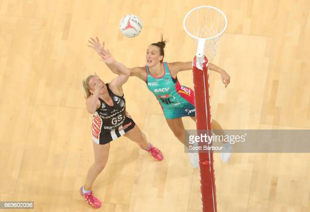 Caitlin Thwaites of the Magpies and Emily Mannix of the Vixens compete for the ball during the round seven Super Netball match between the Magpies...