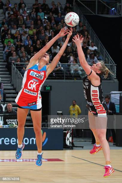 Caitlin Thwaites of the Magpies and Sarah Klau of the Swifts compete in the air during the round 12 Super Netball match between the Magpies and the...