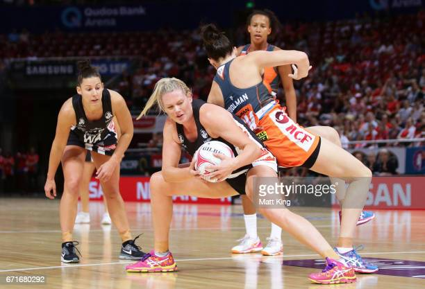 Caitlin Thwaites of the Magpies is challenged by Sam Poolman of the Giants during the round nine Super Netball match between the Giants and the...