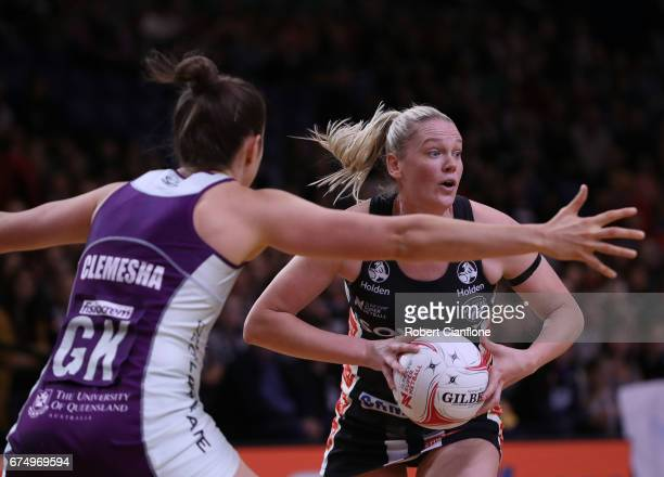 Caitlin Thwaites of the Magpies looks to pass the ball during the round 10 Super Netball match between the Magpies and the Firebirds at the...