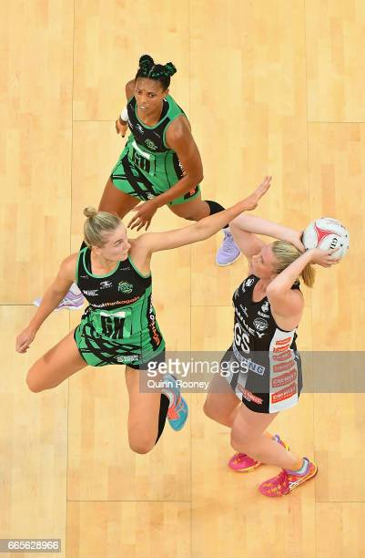 Caitlin Thwaites of the Magpies shoots as Courtney Bruce of the Fever defends during the round eight Super Netball match between the Magpies and...