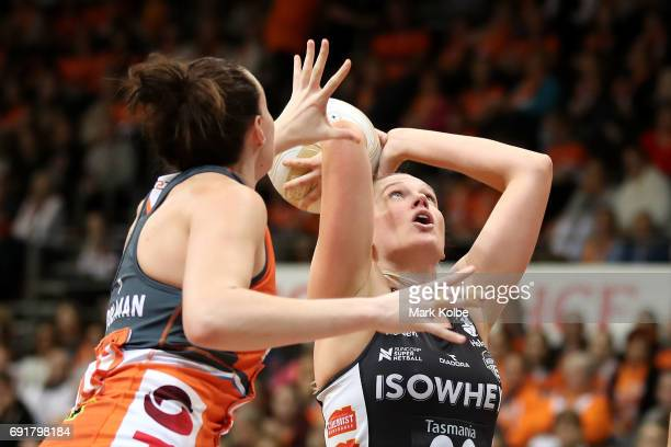 Caitlin Thwaites of the Magpies shoots at goal under pressure from Bec Bulley of the Giants during the Super Netball Major Semi Final match between...