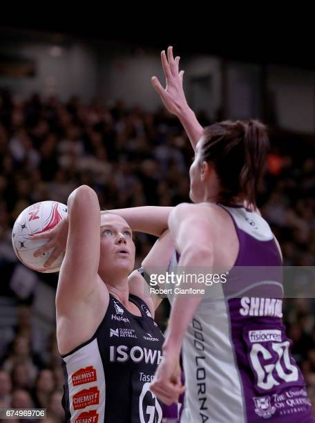 Caitlin Thwaites of the Magpies shoots over Kate Shimmin of the Firebirds during the round 10 Super Netball match between the Magpies and the...