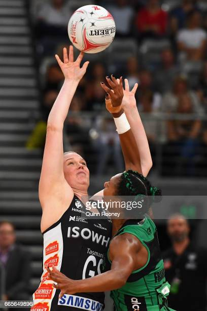 Caitlin Thwaites of the Magpies shoots over the top of Stacey Francis of the Fever during the round eight Super Netball match between the Magpies and...
