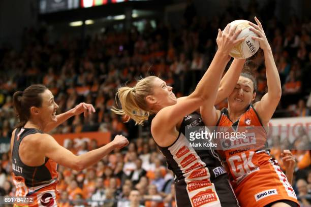 Caitlin Thwaites of the Magpies Toni Anderson Sam Poolman of the Giants contest the ball during the Super Netball Major Semi Final match between the...
