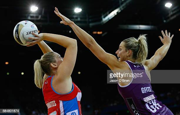 Caitlin Thwaites of the swifts competes for the ball with Laura Geitz of the firebirds during the 2016 ANZ Championship Grand Final match between the...