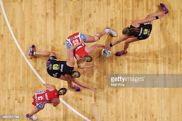Caitlin Thwaites of the Swifts competes with Casey Kopua and Leana de Bruin of the Magic during the ANZ Championship Minor Semi Final match between...