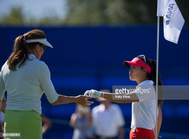Caitlyn Jenner and LPGA player Danielle Kang chat on the 9th green during the ANA Inspiration ProAm at Mission Hills Country Club on March 29 2017 in...