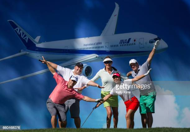Caitlyn Jenner and LPGA player Danielle Kang pose with their ProAm group on the tee box of the 8th hole during the ANA Inspiration ProAm at Mission...
