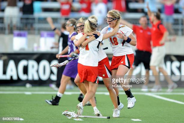 Caitlyn McFadden Sarah Mollison and Karri Ellen Johnson of the University of Maryland celebrate after winning the National Championship against the...