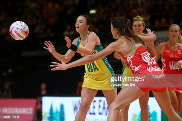 Caitlyn Nevins of Australia passes past Beth Cobden of England during the Quad Series netball match between the England Roses and the Australia...