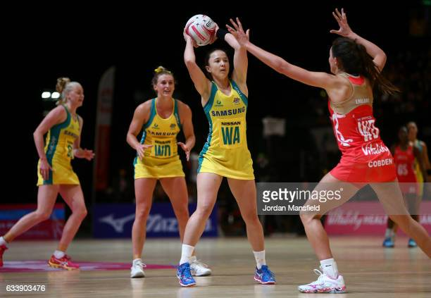 Caitlyn Nevins of Australia throws past Beth Cobden of England during the Quad Series netball match between the England Roses and the Australia...