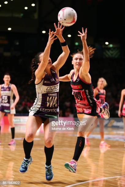Caitlyn Nevins of the Firebirds and Jade Clarke of the Tunderbirds compete for the ball during the round six Super Netball match between the...