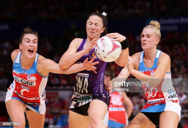 Caitlyn Nevins of the Firebirds is challenged by Maddy Proud and Maddy Turner of the Swifts during the round 14 Super Netball match between the...