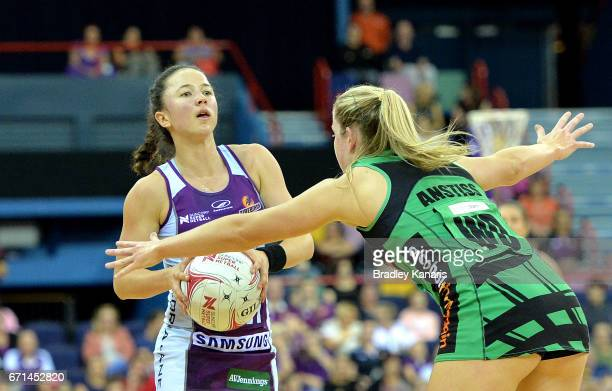 Caitlyn Nevins of the Firebirds looks to pass during the round nine Super Netball match between the Firebirds and the Fever at Brisbane Entertainment...