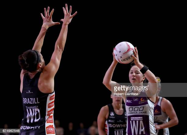 Caitlyn Nevins of the Firebirds looks to pass the ball during the round 10 Super Netball match between the Magpies and the Firebirds at the...