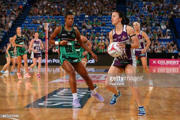 Caitlyn Nevins of the Firebirds looks to pass the ball during the round three Super Netball match between the Fever and the Firebirds at Perth Arena...